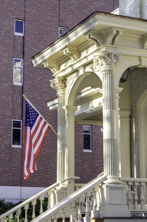 neoclassic: American flag against brick wall with antic columns