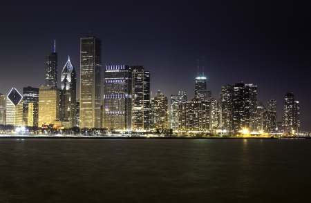 Chicago skyline by night illuminated by financial buildings