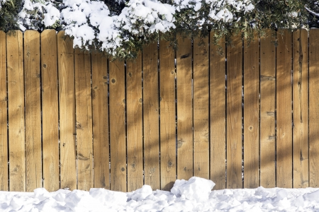 old wood floor: Wooden fence with snow on the ground