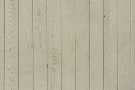 Vertical wooden fence close up photo