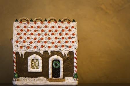 Gingerbread house on brown background photo
