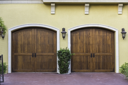 Two car wooden arch garage in South Florida photo