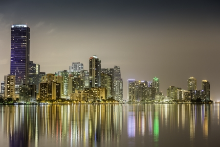 Miami downtown at night illuminated by business and luxury residential buildings in Florida 스톡 콘텐츠