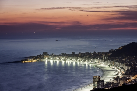 Copacabana Beach at night in Rio de Janeiro, Brazil photo
