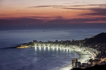 Copacabana Beach at night in Rio de Janeiro, Brazil photo