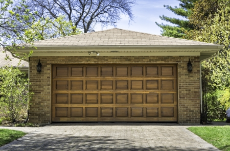 car garage: Traditional two car wooden garage Stock Photo