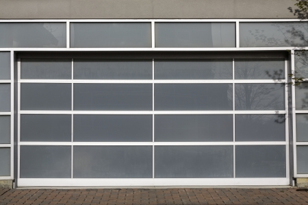 panel: Access to a modern glass door panel garage