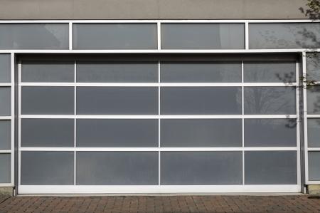 Access to a modern glass door panel garage