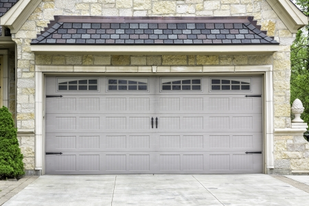 garage door: Traditional two car wooden garage Stock Photo