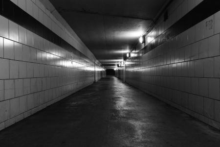 Dark empty tunnel at night photo