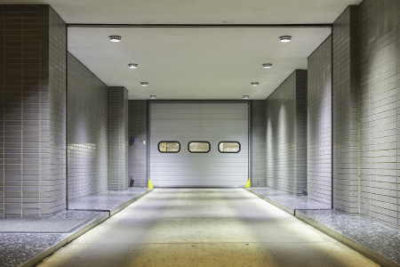 Illuminated entrance door to underground garage photo