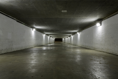 Empty tunnel at night photo