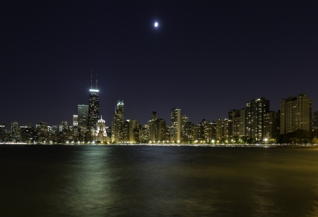 Moon over Chicago Downtown at night photo