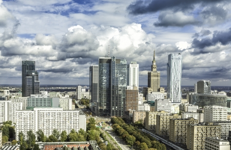 Downtown Warsaw at sunny autumn afternoon with dramatic clouds, Poland