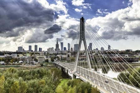 agglomeration: Warsaw skyline behind the bridge, Poland Stock Photo