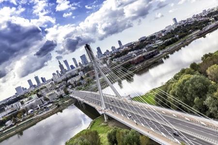 Warsaw skyline behind the bridge, Poland 스톡 콘텐츠