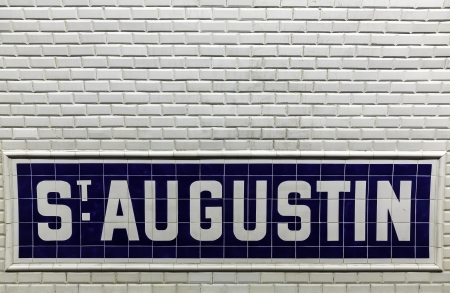 Tiles background of Paris metro station sign in France Stock Photo