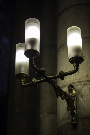 Gothic church with old fashioned wall lamp photo
