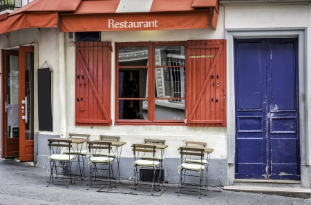 French restaurant with tables and chairs on the street of Paris, France