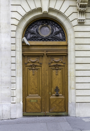 Wood entry door with camera - Paris, France photo