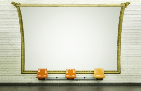 Blank billboard in Paris subway station with empty chairs