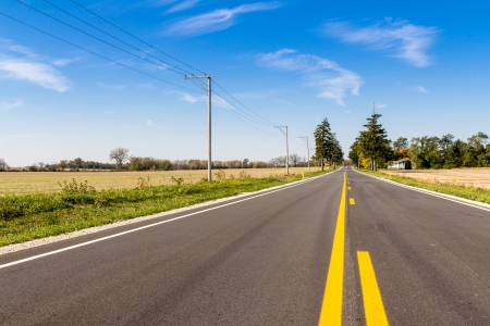 iowa agriculture: Asphalt country road with horizon