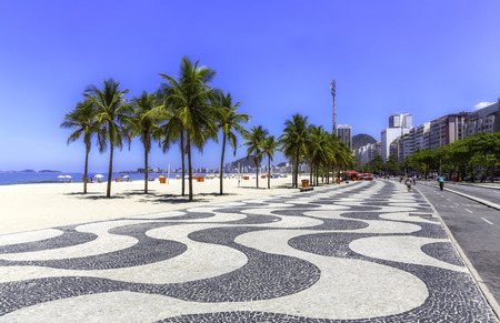 Copacabana beach with palms and sidewalk in Rio de Janeiro, Brazil Stock Photo