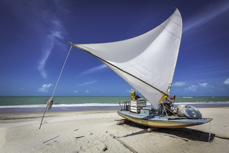 Small fishing boat on the beach of Natal, Brazil photo