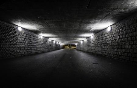 Empty dark tunnel at night photo