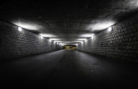 Empty dark tunnel at night photo
