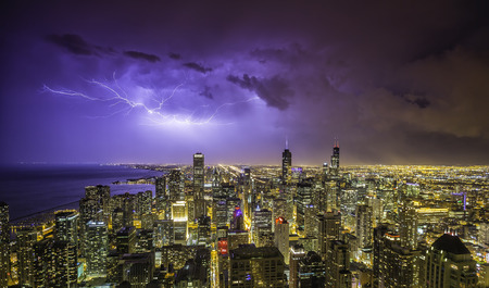 Chicago downtown night panorama during thunderstorm Imagens