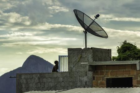 illiteracy: Boy watching tv in Favela  slums  in Rio de Janeiro  in Rio de Janeiro