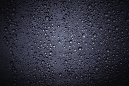 Water droplets on the glass with a colored background Stock Photo