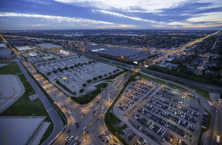 congested: Aerial view of city parking at dusk Stock Photo