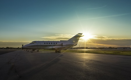 Business plane at airport during sunset 版權商用圖片 - 29382761