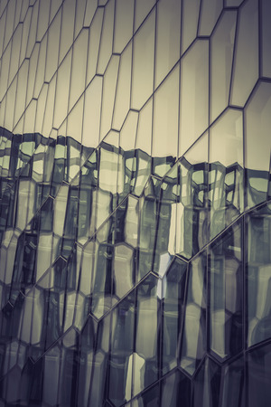 glass reflection: Glass facade with reflection of abstract building, dim light