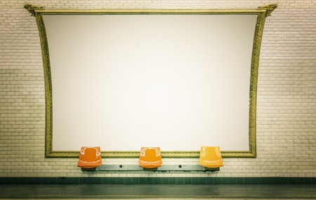 Empty billboard in Paris subway station with empty chairs