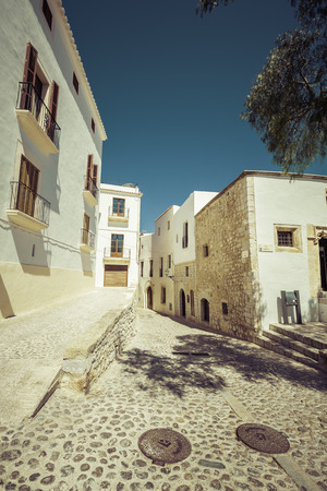 Typical street in old town of Ibiza, in Balearic Islands, Spain - vintage look Imagens