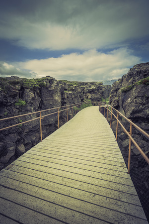 Wooden empty bridge path in Iceland mountains