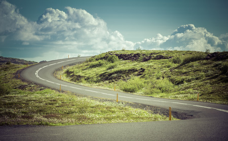 curve road: Curved asphalt road in high mountains of Iceland