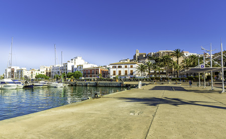 Ferry station in the port of Ibiza with Old Town, Spain