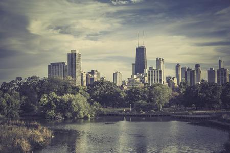 city park skyline: City park against Chicago Downtown skyline - vintage look