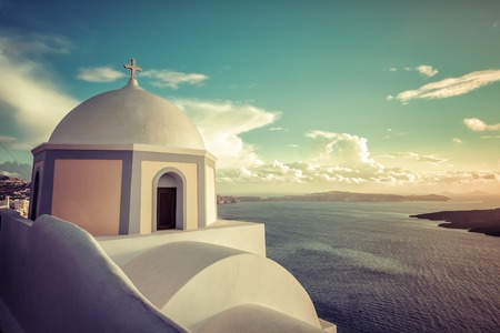 Traditional church on the cliff in Fira, Santorini Island in Greece photo