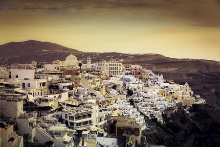 Beautiful sunset over town of Fira, Santorini Island - Greece photo