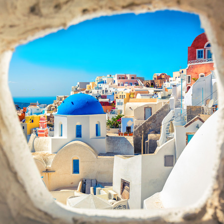 greece: Santorini blue dome church look through the chimney, Greece Stock Photo
