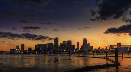 Miami city skyline at dusk with urban skyscrapers with reflection, Florida photo
