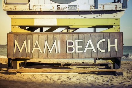 south beach: Miami Beach sign on wood background, South Beach, Florida
