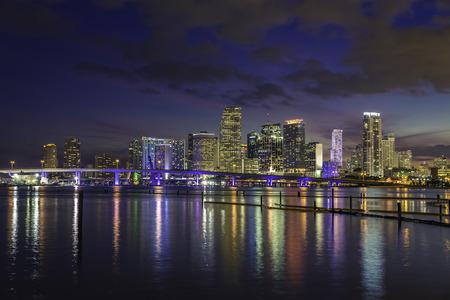 Miami city skyline at dusk with urban skyscrapers , Florida photo