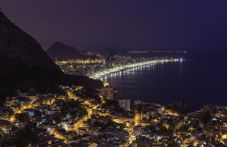 brazil beach: Night panorama of Rio de Janeiro with water reflections, Brazil