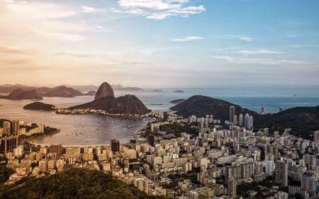 Beautiful panorama of Rio de Janeiro during sunset with red light leak, Brazil photo